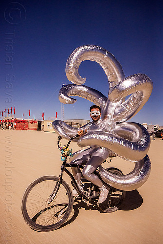 shiny inflatable costume with tentacles - burning man 2015, arms, beard, bicycle, bike, burning man, inflatable costume, mask, masked, riding, shiny, tentacles, unidentified art