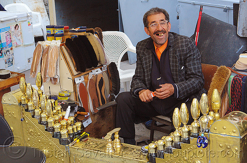 shoeshiner in his stand, golden, man, market, shoeshiner stand, stall, street vendor