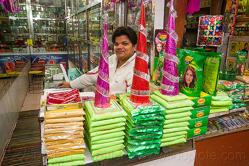 shop selling herbal mehndi (delhi), cones, delhi, dye, green bags, henna paste, herbal mehndi, man, merchant, selling, shop, store, supplies, vendor