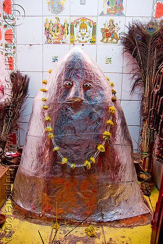 shrine to khandoba, flower necklace, hindu deity, hindu god, hindu shrine, hinduism, hingu temple, khanderao, khanderaya, khandoba, mailar malanna, mailara linga, malhari martand, mallanna, mallu khan, mārtanda bhairava, offerings, peacock feathers, religion, shiny, shiva lingam, statue