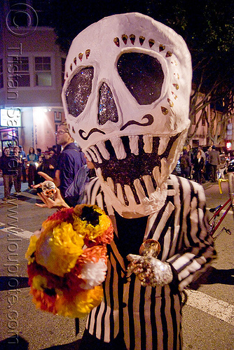 skull - giant puppet - dia de los muertos - halloween (san francisco), day of the dead, face painting, facepaint, flowers, makeup, night, paper mache, papier-mache, papier-mâché, people, woman