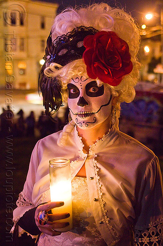 skull makeup and victorian attire - white wig - red flower headdress, candle light, class candle, day of the dead, dia de los muertos, face painting, facepaint, halloween, lace, mexican candle, night, red flower headdress, sugar skull makeup, white wig, woman