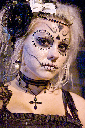 skull makeup - black bindis - dia de los muertos - halloween (san francisco), bindis, cross, day of the dead, dia de los muertos, face painting, facepaint, halloween, night, sugar skull makeup, woman