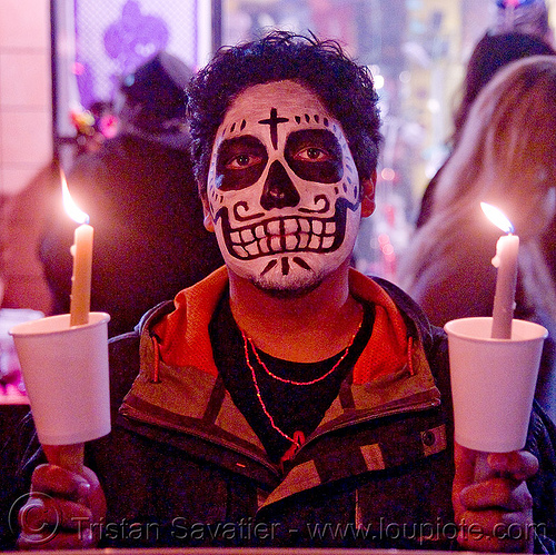 skull makeup - candles - dia de los muertos - halloween (san francisco), candlelight vigil, candles, day of the dead, dia de los muertos, face painting, facepaint, halloween, man, night, sugar skull makeup