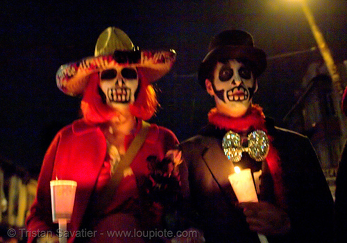skull makeup - couple with candles - dia de los muertos - halloween (san francisco), candlelight vigil, candles, costumes, day of the dead, dia de los muertos, face painting, facepaint, halloween, night, sugar skull makeup
