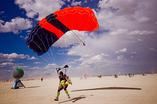 skydiver touching down - burning man 2012, burning sky, landing, parachute, parachutist, skydiver, touch-down