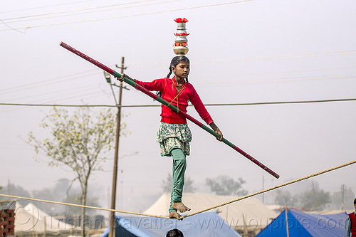 slacklining - slack rope walking - street circus artist (india), acrobat, balancing pole, balancing stick, child, circus act, circus artist, circus performer, equilibrist, hindu pilgrimage, hinduism, india, kid, little girl, maha kumbh mela, rope walker, rope walking, slack rope, slacklining, traveling circus, woman