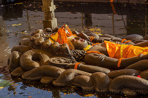 sleeping vishnu - budhanikantha temple (nepal), 11, budhanikantha temple, eleven-head, eleven-headed, floating vishnu, flower offerings, hindu temple, hinduism, jalakshayan narayan, lying down, marigold flowers, naga snake, nāga snake, orange flowers, pond, pool, sculpture, sleeping vishnu, statue, water