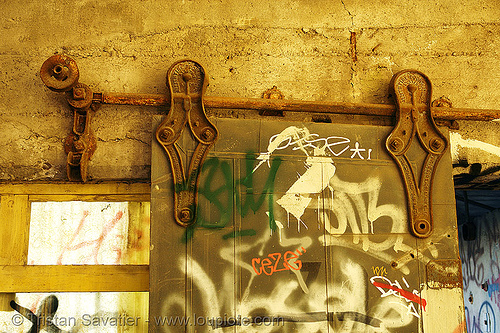 sliding door wheels, derelict, fire door, graffiti, rail, railing, sliding door, street art, tie's warehouse, trespassing