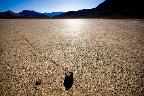 sliding rocks on the racetrack (death valley), backlight, cracked mud, crossing, death valley, dry lake, dry mud, mountains, racetrack playa, sailing stones, sliding rocks