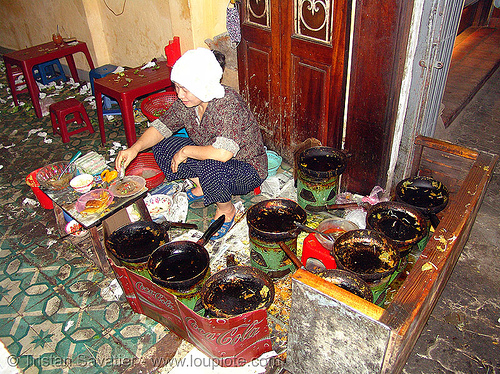 small but excellent restaurant - vietnam, asian woman, cook, cooking, eatery, food, hanoi, pans, people
