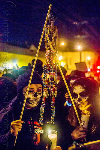 small decorative skeletons - dia de los muertos procession (san francisco), beads, candle, day of the dead, face painting, facepaint, halloween, hanging, makeup, night, people, skull makeup, women