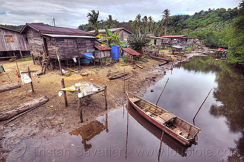 small village near river (borneo), boat landing, borneo, houses, malaysia, mangrove, mooring poles, rain forest, river boat, rowing boat, small boats, village