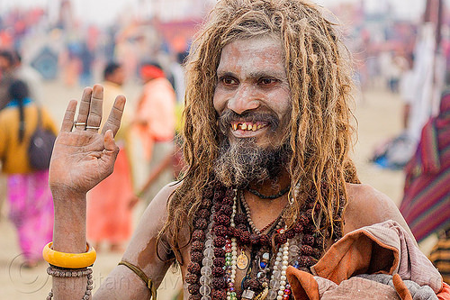 smiling sadhu covered with vibhuti sacred ash - hinduism (india), baba, bad teeth, beard, dreadlocks, hindu pilgrimage, hinduism, holy ash, india, maha kumbh mela, man, necklaces, rudraksha beads, sacred ash, sadhu, vibhuti