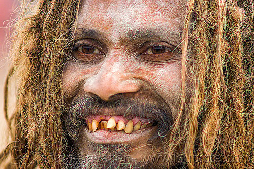 smiling sadhu with bad teeth, baba, bad teeth, beard, dreadlocks, hindu pilgrimage, hinduism, holy ash, india, maha kumbh mela, man, sacred ash, sadhu, vibhuti