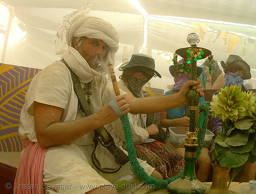smoking a hookah in center camp - burning man 2007, burning man, center camp, hookah, nargeela, narghile, nargile, nargileh, narguilé, sheesha, shisha, smoking, water pipe