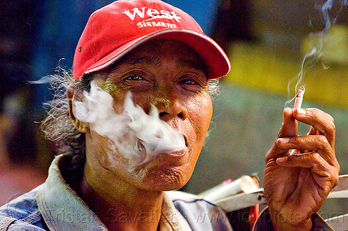exhaling smoke, cap, cigarette, hand, java, jogja, jogjakarta, malioboro, man, night, people, rickshaw driver, smoker, smoking, yogyakarta