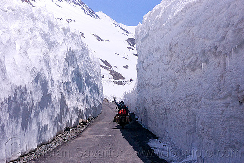 snow walls near baralacha pass - manali to leh road (india), baralacha pass, baralachala, ben, ladakh, motorbike touring, motorcycle touring, mountain pass, mountains, rider, riding, road, royal enfield bullet, snow walls