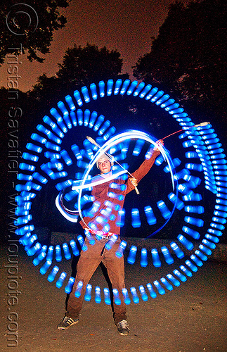 spinning blue LED light poi - flowlights (san francisco), fire dancer, fire dancing, fire performer, fire spinning, flowtoys, glowing, led lights, led poi, led staff, light staffs, long exposure, nicky evers, night, people, spinning fire