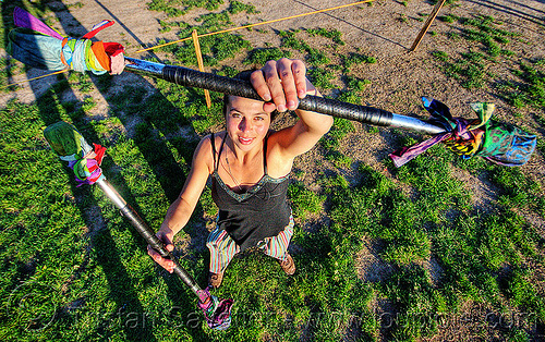 spinning double staff, double staff, lawn, savanna, staves, woman