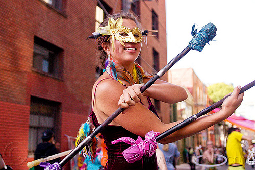 spinning double staff, carnival mask, festival, golden mask, how weird festival, people, savanna, staffs, staves, woman