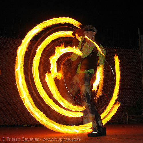 spinning a fire hula hoop - LSD fuego, fire dancer, fire dancing, fire hula hoop, fire performer, fire poi, fire spinning, hula hooping, night, spinning fire