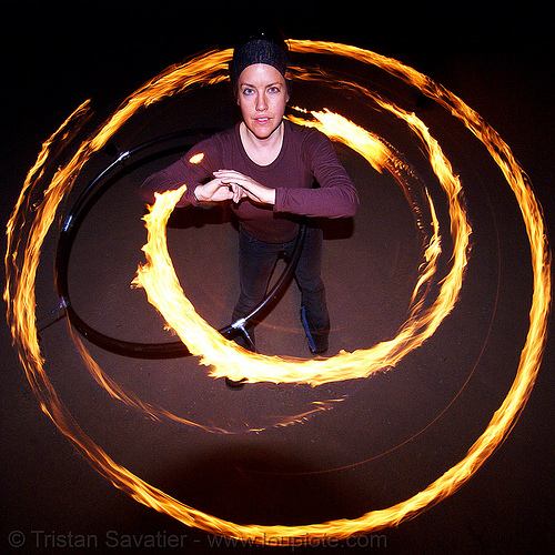 spinning a fire hula hoop (san francisco), fire dancer, fire dancing, fire performer, fire spinning, flames, hula hooping, long exposure, night, people, spinning fire