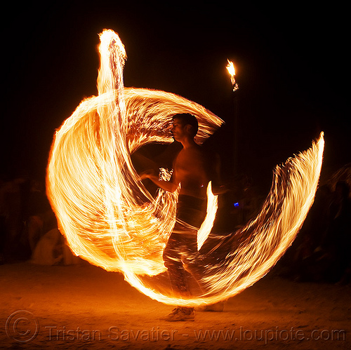 spinning fire ropes - burning man 2009, fire dancing, fire performer, fire spinning, flame, long exposure, man, night, rire rope, spinning fire