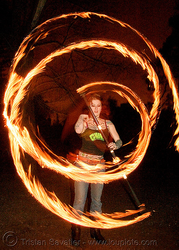 spinning fire staff (san francisco) - fire dancer - leah, fire dancer, fire dancing, fire performer, fire spinning, flames, leah, long exposure, night, spinning fire, tattooed, tattoos, woman
