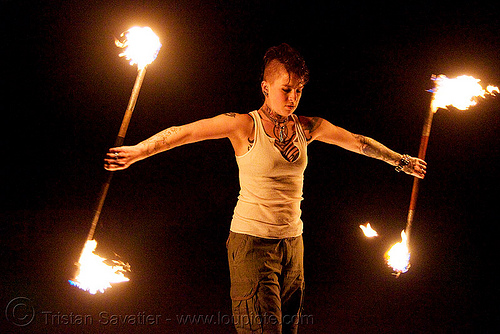 spinning fire staffs (san francisco) - fire dancer - leah, double staff, fire dancing, fire performer, fire spinning, fire staves, flame, night, people, tattooed, tattoos, woman