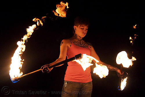 spinning fire staffs (san francisco) - fire dancer - leah, double staff, fire dancing, fire performer, fire spinning, fire staves, flames, night, people, tattooed, tattoos, woman