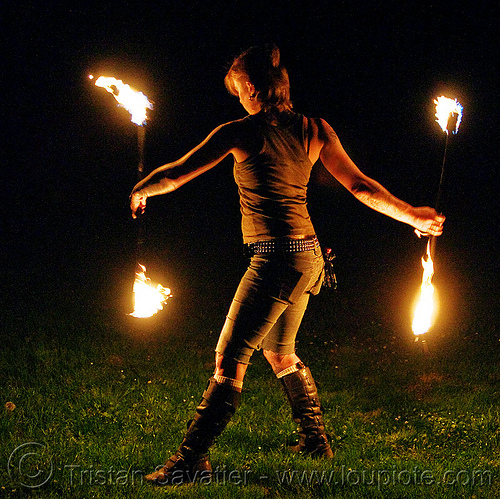 spinning fire staves on the grass - leah, backlight, boots, fire dancer, fire dancing, fire performer, fire spinning, fire staffs, fire staves, grass, lawn, leah, low key, night, woman