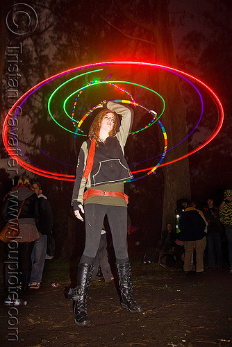 spinning a hula hoop with photon LED lights, full moon party, glowing, golden gate park, hooper, hula hoop, hula hooping, led hoop, led lights, light hoop, microlights, night, rave lights, woman