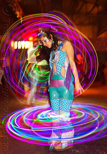spinning LED hoops, cell space, glowing, grace hoops, hooper, hula hoop, led hoops, led lights, light hoop, night, woman