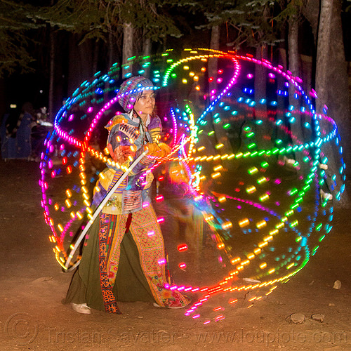 spinning a LED hulahoop, glowing, hooping, hulahoop, led hoop, led lights, light hoop, lotus maca moon, night, rainbow colors, star camp, woman
