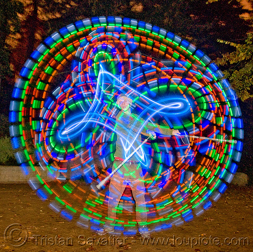 spinning LED light poi - glowing - flowlight, circle, fire dancer, fire dancing, fire performer, fire spinning, flowlights, flowtoys, glowing, led lights, led poi, light poi, long exposure, man, nicky evers, night, ring, spinning fire