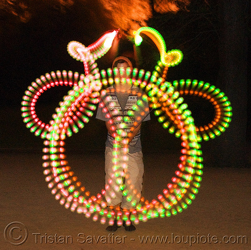 spinning LED light poi - glowing - flowlight, fire dancer, fire dancing, fire performer, fire spinning, flowlights, flowtoys, led lights, led poi, long exposure, loops, man, nicky evers, night, people, spinning fire, symmetrical, vertical symmetry