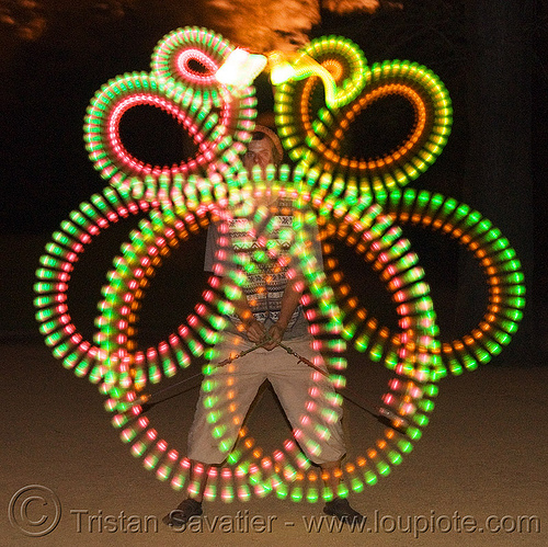 spinning LED light poi - glowing - flowlight, fire dancer, fire dancing, fire performer, fire spinning, glowing, led lights, led poi, led staff, light poi, loops, man, nicky evers, night, spinning fire, vertical symmetry