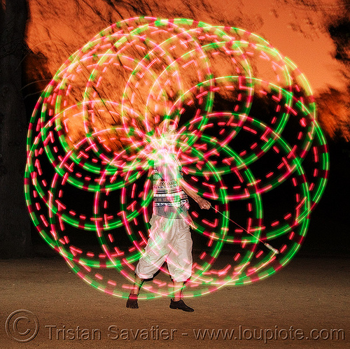 spinning LED light poi - rosace - glowing - flowlight, fire dancer, fire dancing, fire performer, fire spinning, glowing, led lights, led poi, light poi, man, nicky evers, night, rosace, spinning fire