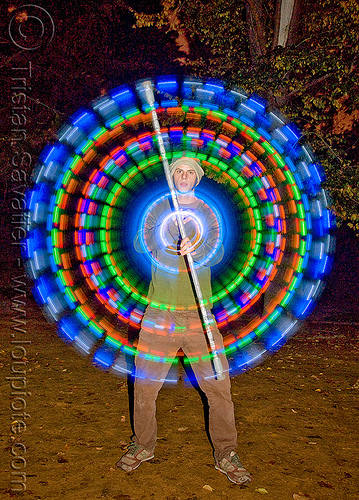 spinning LED light staff - glowing - flowlight, circle, fire dancer, fire dancing, fire performer, fire spinning, glowing, led lights, led staff, light staff, man, nicky evers, night, ring, spinning fire