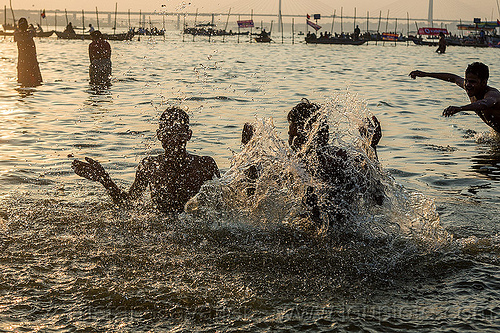 splashing water - hindu devotees taking holy dip in ganges river (india), backlight, ganga river, ganges river, hindu, hinduism, holy bath, holy dip, kumbha mela, maha kumbh mela, river bank, river bath, river bathing, splash, splashing, triveni sangam, water