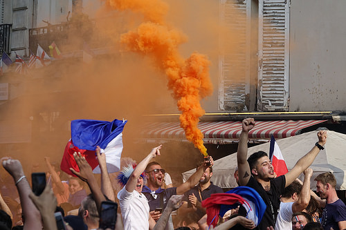 spontaneous street celebration of france winning soccer world championship - finale coupe du monde de football 2018 - supporters (paris), allez les bleus, bleu blanc rouge, coupe du monde de football 2018, crowd, dancing, fifa, french flags, on a gagné, orange smoke, paris, place de la contrescarpe, smoke bombs, soccer world cup 2018, street party