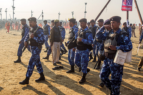 squad of indian army commando at kumbh mela (india), ak-47, akm, armed, army, assault weapons, automatic weapons, bulletproof vests, commando, crowd control, fatigues, hindu pilgrimage, hinduism, india, insas rifles, kumbh maha snan, law enforcement, maha kumbh mela, mauni amavasya, men, military, police, soldiers, squad, triveni sangam, troops, uniform, walking