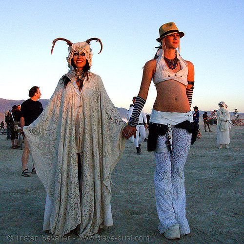 stardust at the silent white procession at dawn - burning man 2007, fedora hat, gangster hat, horns, people, sun rise, white morning, women