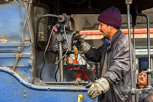 steam locomotive operator adjusting hydrostatic lubricator with adjustable wrench - darjeeling (india), 788 tusker, cab, controls, darjeeling himalayan railway, darjeeling toy train, hydrostatic displacement lubricator, hydrostatic lubricator, man, mechanical lubricator, narrow gauge, operator, railroad, steam engine, steam locomotive, steam train engine, valves, worker, working, wrench