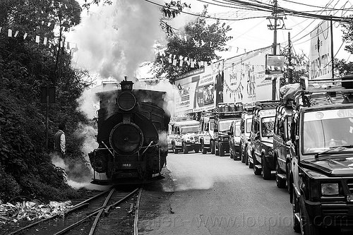 steam locomotive sharing road with cars - darjeeling (india), 788 tusker, cars, darjeeling himalayan railway, darjeeling toy train, narrow gauge, railroad switch, railroad tracks, rails, road, smoke, smoking, steam engine, steam locomotive, steam train engine, street, traffic jam