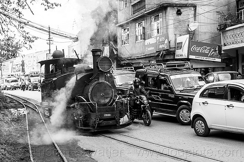 steam locomotive sharing road with cars traffic - darjeeling (india), 788 tusker, cars, darjeeling himalayan railway, darjeeling toy train, india, motorcycle, narrow gauge, railroad switch, railroad tracks, road, smoke, smoking, steam engine, steam locomotive, steam train engine, traffic jam