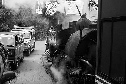 steam train sharing the road with cars - darjeeling (india), 788 tusker, cars, darjeeling himalayan railway, darjeeling toy train, india, man, narrow gauge, operator, railroad, road, smoke, smoking, steam engine, steam locomotive, steam train engine, train car