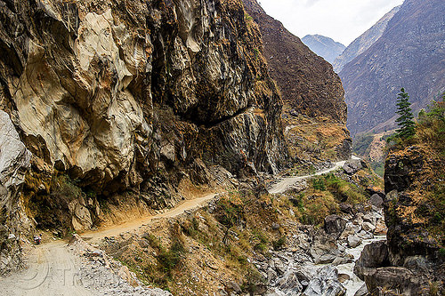 steep valley between tatopani and jomsom (nepal), annapurnas, cliff, dirt road, kali gandaki river, kali gandaki valley, motorcycle touring, mountain road, mountains, stream, unpaved