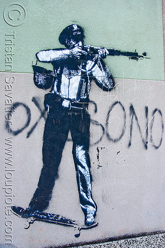 stencil graffiti - police on skateboard shooting a rifle, buenos aires, cop, gun, hand gun, la boca, law enforcement, shot gun, street art